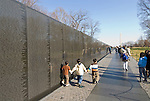 Washington DC; USA: Children at The Vietnam Veterans Memorial on the Mall.  A wall of names records all those who died..Photo copyright Lee Foster Photo # 8-washdc76228