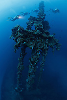 RJ41388-D. scuba divers ascending to the surface behind the huge mast of the Nippo Maru shipwreck, part of the Japanese fleet sunk by the Americans in World War II during an epic two day battle in February, 1944. Truk (Chuuk) Lagoon, Micronesia, Pacific Ocean.<br /> Photo Copyright &copy; Brandon Cole. All rights reserved worldwide.  www.brandoncole.com