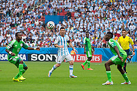 Lionel Messi of Argentina takes on Nigeria defence