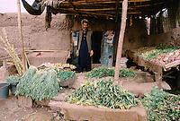 Green vegetables in a Afghan refugee shop in Peshawar, Pakistan