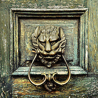 An antique door knocker is seen hung on the wooden door of a Spanish colonial house in Morelia, Mexico, 2 November 2014.