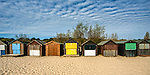A row of beach changing huts