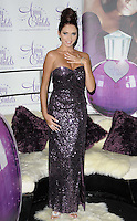Amy Childs.The photocall to launch her debut fragrance in collaboration with Jigsaw, Aura bar & nightclub, London, England..August 15th, 2012.full length purple strapless dress  sequins sequined hair up bun hand arm.CAP/CAN.©Can Nguyen/Capital Pictures.