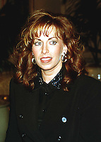 Paula Jones walks to a press conference called by Abe Hirschfeld where she received a check for one million dollars to settle her sexual harassment lawsuit against United States President Bill Clinton at the Mayflower Hotel in Washington, DC on 31 October, 1998.<br /> Credit: Ron Sachs / CNP /MediaPunch