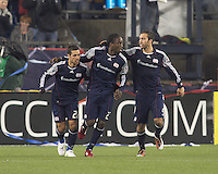 New England Revolution midfielder Shalrie Joseph (21) celebrates his goal with teammates. In a Major League Soccer (MLS) match, the New England Revolution defeated Sporting Kansas City, 3-2, at Gillette Stadium on April 23, 2011.