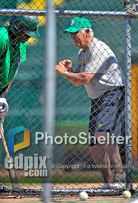 30 June 2012: Vermont Lake Monsters Manager Rick Magnante shares hitting tips prior to a game against the Lowell Spinners at Centennial Field in Burlington, Vermont. Mandatory Credit: Ed Wolfstein Photo