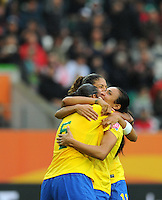 Marta (r) of team Brazil celebrates with Rosana (l) and Cristiane during the FIFA Women's World Cup at the FIFA Stadium in Wolfsburg, Germany on July 3rd, 2011.