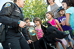 Youth gather around the Los Altos K9 officer, Lord, during a visit to a National Night Out gathering at Montclaire Elementary School in Los Altos, CA August 6.