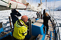 Norway, Svalbard, tourists looking for polar bears on frozen fjord on board Arctica