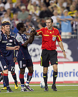 New England Revolution defender Emmanuel Osei (5) discusses penalty kick call by Paul Ward. The New England Revolution tied Columbus Crew, 2-2, at Gillette Stadium on September 25, 2010.