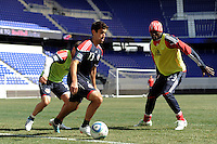 Austin da Luz (13) of the New York Red Bulls plays the ball as Matt Kassel (15) and Tony Tchani (23) defend during practice on Media Day at Red Bull Arena in Harrison, NJ, on March 15, 2011.