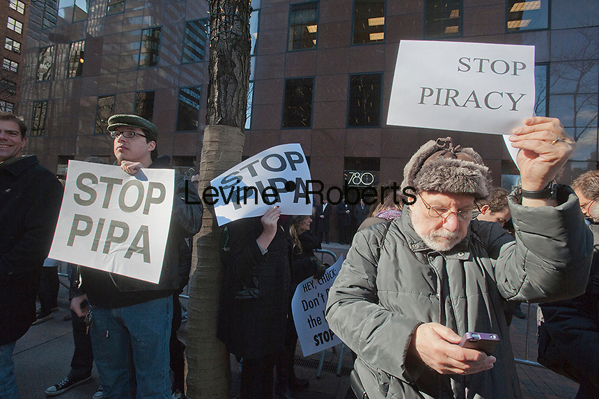 Several hundred members and supporters of the NY Tech Meetup group protest outside the offices of US Senators Kirsten Gillibrand and Charles Schumer in New York on Wednesday, January 18, 2012 over legislation concerning online piracy. The demonstrators were against the proposed Stop Online Piracy Act (SOPA) and the Protect IP Act (PIPA) which they feel will allow US authorities to shutdown websites that are accused of online piracy without due process and threatens the freedom of the internet. (© Richard B. Levine)