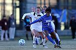 29 November 2013: Duke's Natasha Anasi (4) and Virginia Tech's Ashley Meier (left). The Virginia Tech University Hokies played the Duke University Blue Devils at Thompson Field in Blacksburg, Virginia in a 2013 NCAA Division I Women's Soccer Tournament Quarterfinal match. Virginia Tech won the game 3-0.