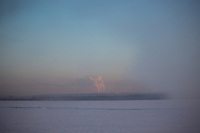 Smokestacks stand above farm fields outside Ufa, Bashkortostan, Russia. The region is a major oil and gas producing region in the country.