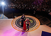 United States President Barack Obama dances with Staff Sergeant Bria D. Nelson of the Air Force as first lady Michelle Obama dances with Gunnery Sergeant Timothy D. Easterling of the Marine Corps at the Commander-in-Chief's Inaugural Ball in Washington, at the Washington Convention Center during the 57th Presidential Inauguration Monday, Jan. 21, 2013. .Credit: Pablo Martinez Monsivais / Pool via CNP