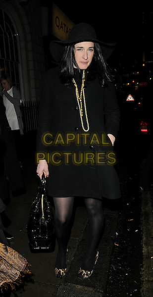 AMY MOLYNEAUX.Spotted leaving Sketch bar & nightclub on their way to the Peaches Geldof for PPQ launch party at M*vida bar & nightclub, Argyll St., London, England..November 27th, 2008.movida full length black dress coat hat jacket leopard print shoes bag purse necklaces hand in pocket .CAP/CAN.©Can Nguyen/Capital Pictures.