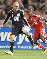 Kurt Morsink #6 of D.C. United sends the ball away from Nicholas Lindsay #37 of Toronto FC during an MLS match that was the final appearance of D.C. United's Jaime Moreno at RFK Stadium, in Washington D.C. on October 23, 2010. Toronto won 3-2.