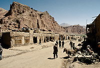 The Bamiyan Bazaar in 1995. .On the left cliff, the niche of the 54 meters statue of Buddha and on the right cliff, the niche of the 34meters statue of Buddha. (See the next picture in 1999 of the same Bazaar but destroy by the Taleban)