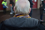 Motherwell 3 Dundee 1, 12/12/2015. Fir Park, Scottish Premiership. A man with grey hair and a striped scarf waiting for friends outside the Davie Cooper Stand at Fir Park, home to Motherwell Football Club, before they played Dundee in a Scottish Premiership fixture. Formed in 1886, the  home side has played at Fir Park since 1895. Motherwell won the match by three goals to one, watched by a crowd of 3512 spectators. Photo by Colin McPherson.