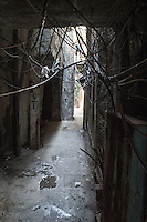 Narrow small passage between houses in the Shatila camp. Beirut, Lebanon August 2015