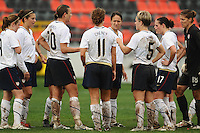 A muddied USWNT huddles to discuss strategy mid-game. The USA defeated Norway 2-1 at Olhao Stadium on February 26, 2010 at the Algarve Cup.
