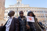 Roma 21 Aprile 2015<br /> Manifestazione  nazionale delle associazioni di migranti, sindacati e ONG, in Piazza Montecitorio, all&rsquo;indomani del naufragio che ha causato la morte di 900 migranti, per chiedere un corridoio umanitario e una politica di accoglienza dignitosa.<br /> Rome April 21, 2015<br /> National demonstration of migrant associations, trade unions and NGOs, in Piazza Montecitorio, in the aftermath of the wreck that caused the death of 900 migrants, ask for a humanitarian corridor and a policy of dignified reception.