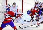 10 February 2010: Washington Capitals' goaltender Michal Neuvirth makes a first period save against the Montreal Canadiens at the Bell Centre in Montreal, Quebec, Canada. The Canadiens defeated the Capitals 6-5 in sudden death overtime, ending Washington's team-record winning streak at 14 games. Mandatory Credit: Ed Wolfstein Photo