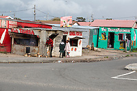 South Africa, Cape Town, Guguletu Township.  Street Scene, Food Shop, Beauty Shop (Hair Salon).