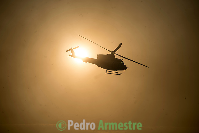 A helicopter of the Members of the BRIF (reinforcement brigade wildfires) flys above the site of a wildfire in Gundín, in Cualedro, near Ourense on August 30, 2015. A fire broke out on August 30, 2015 around noon in the Cualedro town in Galicia, northwest Spain, affecting at least 3,180 hectares of forest, as seven fires continued to burn in Spain, three in Galicia, one in Cantabria, one in Castile and Leon, one in Catalonia and Extremadura. © Pedro ARMESTRE