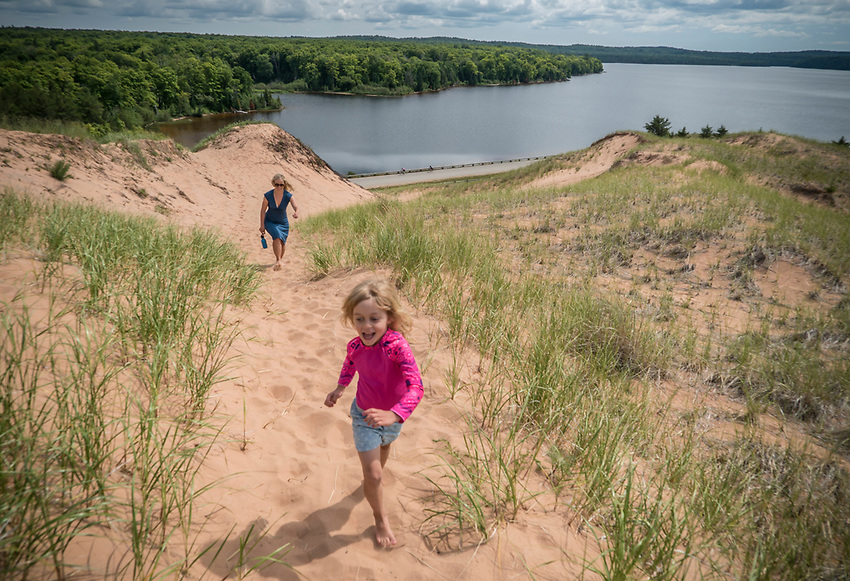Exploring the Grand Sable Dunes of Pictured Rocks National Lakeshore near Grand Marais, Michigan.