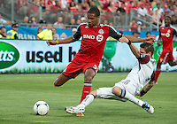 18 July 2012: Toronto FC foward/midfielder Ryan Johnson #9 and Colorado Rapids defender Drew Moor #3 in action during an MLS game between the Colorado Rapids and Toronto FC at BMO Field in Toronto..Toronto FC won 2-1..