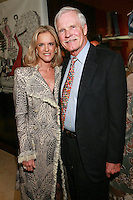 "Ted Turner and guest at the Rebecca Moses ""A Life of Style"" book signing at Fratelli Rossetti Boutique, November 11, 2010."