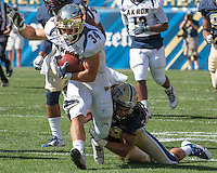 Pitt defensive back Ryan Lewis (38) tries to drag down Akron running back Conor Hundley (34) . The Akron Zips Defeated the Pitt Panthers 21-10 at Heinz Field, Pittsburgh. Pennsylvania on September 27, 2014.