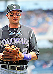 10 July 2011: Colorado Rockies All-Star shortstop Troy Tulowitzki trots back to the dugout during a game against the Washington Nationals at Nationals Park in Washington, District of Columbia. The Nationals shut out the visiting Rockies 2-0 salvaging the last game their 3-game series at home prior to the All-Star break. Mandatory Credit: Ed Wolfstein Photo