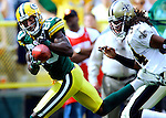 Green Bay's Donald Driver hauls in a 42-yard pass to the New Orleans 7-yard line while defended by former Packers Mike McKenzie in the 3rd quarter. .The Green Bay Packers hosted the New Orleans Saints at Lambeau Field Sunday September 17, 2006. Steve Apps-State Journal.
