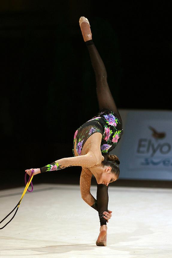 Alina Kabaeva of Russia pirouettes back flexion with rope during All    Alina Kabaeva Gymnastics