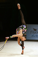 Alina Kabaeva of Russia pirouettes back flexion with rope during All-Around competition at 2006 Thiais Grand Prix in Paris, France on March 25, 2006.  (Photo by Tom Theobald)