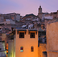 Evening view across the rooftops of Fes, Fes-Boulemane, Northern Morocco. The medina of Fes was listed as a UNESCO World Heritage Site in 1981. Picture by Manuel Cohen
