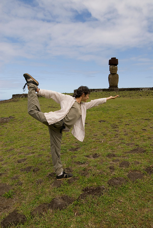 Chile, Easter Island: Yoga practicioner assuming position at Ahu Tahai near Hanga Roa.  Woman yoga practicioner, model released..Photo #: ch237-33621..Photo copyright Lee Foster www.fostertravel.com lee@fostertravel.com 510-549-2202