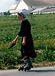 Amish girl roller blade on backroads of Pennsylvania, Horse and buggy with amish family on backroads of Pennsylvainia, Commonwealth of Pennsylvania, Penn, Penna, natives, Northeasterners, Middle Atlantic region, Philadelphia, Keystone State, 1802, Thirteen Colonies, Declaration of Independence, State of Independence, Liberty, Conestoga wagons, Quaker Province, Founding Fathers, 1774, Constitution written, Fine Art Photography by Ron Bennett, Fine Art, Fine Art photography, Art Photography, Copyright RonBennettPhotography.com © Fine Art Photography by Ron Bennett, Fine Art, Fine Art photography, Art Photography, Copyright RonBennettPhotography.com ©