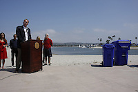 Tuesday, May 12, 2009.  Mission Beach, San Diego, CA, USA.  Kevin Faulconer speaks to the media at the corner of Bayside Walk and Santa Clara place as members of the MB town council look on.  District 2 councilmember Kevin Faulconer announced today that he plans to use $80K of discretionary funds to continue a long-standing program of supplemental trash pick-ups from residents in Mission Beach during the summer months.  The program will be replaced by a curbside recycling progra m in 2010.