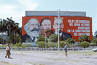 June, 1977. Havana, Cuba. Eighteen years after the Cuban Revolution the first U.S. tourists were permitted to visit Havana. Tourists taking photos of the political billboards.