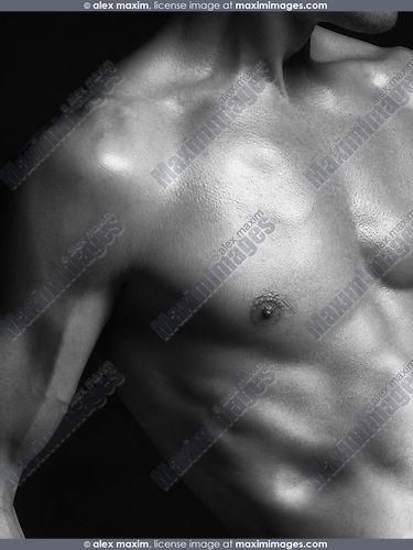 Closeup of fit young man with body parts Black and white