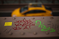 Love words are seen at the Brooklyn Bridge while it remains under maintenance one day before its 130th anniversary in New York,  May 23, 2013, Photo by Eduardo Munoz Alvarez / VIEWpress.