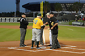 Siena Saints head coach Tony Rossi (40) shakes hands with umpire Olinda Mattia during introductions before the season opening game against the Central Florida Knights at Jay Bergman Field on February 14, 2014 in Orlando, Florida.  UCF defeated Siena 8-1.  (Copyright Mike Janes Photography)