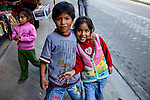 Two Children pose for a picture in Aguas Calientes, Peru