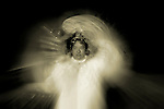 The glowing figure of a woman dressed in white