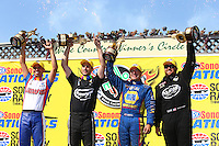 Jul. 28, 2013; Sonoma, CA, USA: NHRA Champions (L-R) Shawn Langdon top fuel dragster, Ron Capps funny car, Vincent Nobile pro stock and Hector Arana Jr pro stock motorcycle celebrate on the podium after winning the Sonoma Nationals at Sonoma Raceway. Mandatory Credit: Mark J. Rebilas-
