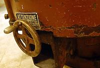 Artigiani a San Lorenzo , quartiere storico di Roma. Craftsmen in San Lorenzo, historic district of Rome. .Said. Antica fabbrica di cioccolata, dal 1923, nello storico quartiere di San Lorenzo. Produzione di cioccolatini, torroni, uova di Pasqua..Old chocolate factory from 1923, in the historical district of San Lorenzo. Production of chocolate, nougat, Easter eggs..Vecchi macchinari e impastatrici originali dell' epoca, come in un museo..Old machinery and mixers original from era, as in a museum.....