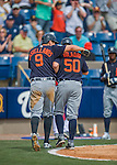 5 March 2016: Detroit Tigers catcher Bryan Holaday returns to the dugout with base-runner Nick Castellanos, after hitting his second home run of the game, a 2-run shot to left field, during a Spring Training pre-season game against the Washington Nationals at Space Coast Stadium in Viera, Florida. The Tigers fell to the Nationals 8-4 in Grapefruit League play. Mandatory Credit: Ed Wolfstein Photo *** RAW (NEF) Image File Available ***